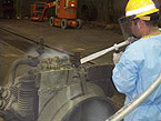 Maintain production equipment by removing grease and other residue buildup with dry ice blasting