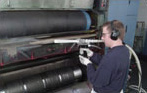 Cleaning a flexograph printing press with dry ice blasting